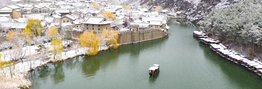 Snow descends on Gubei Water Town in Beijing